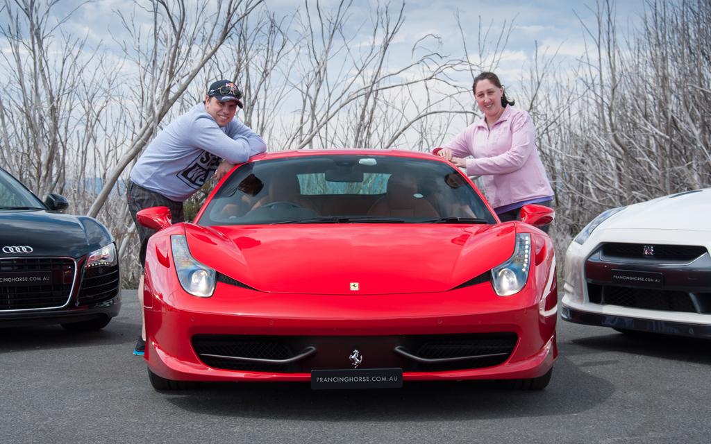 Daniel-Garofalo-and-Annie-with-the-Ferrari-458-Italia-atop-Lake-Mountain-Victoria